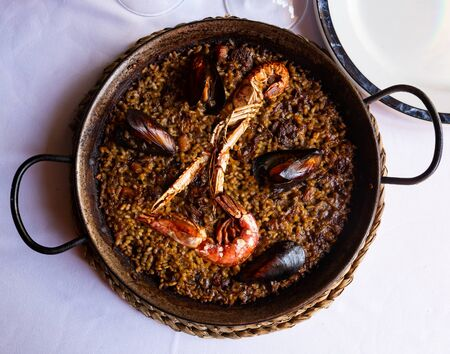 Top view of Valencian paella marinera with mussels and shrimps served in traditional metal pan Stock fotó