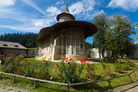 Voronet Monastery church decorated of paintings is cultural attraction from Romania Фото со стока
