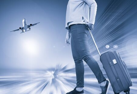 Woman carries luggage on airplane background with effect motion blur