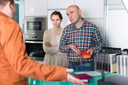 Couple dissatisfied with the quality of the goods in kitchen furniture store