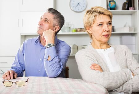 Senior couple quarrels with each other at clarification of the family relation in home