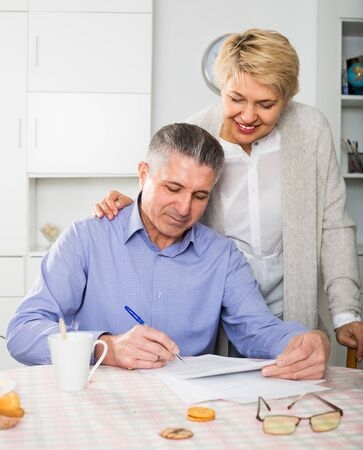 Wife and husband are lead discussion about agreement of the credit.