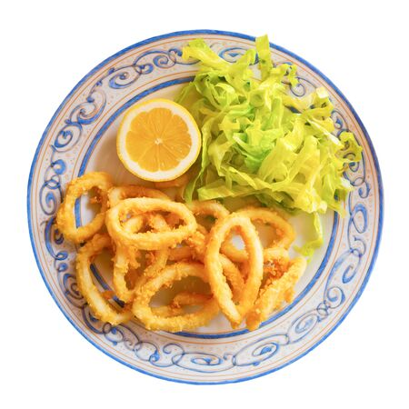 Calamares a la romana fried squid on plate. Traditional spanish dish. Isolated over white background