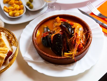Traditional Ligurian seafood stew Cacciucco with shellfish and shrimps. Italian cuisine Reklamní fotografie
