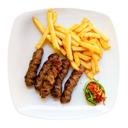 Cevapcici with french fries. Balkan cuisine. Isolated over white background