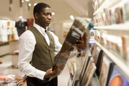 Portrait of mature African man standing near souvenir shop at Art Museum 版權商用圖片