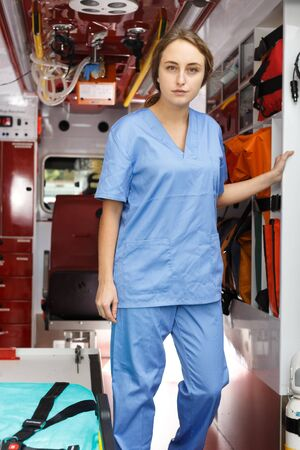 Portrait of confident female emergency doctor in ambulance car