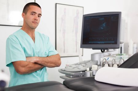Portrait of young man hospital doctor in cabinet of ultrasound test