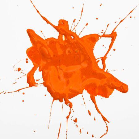 Orange acrylic paint blot isolated on white background 写真素材