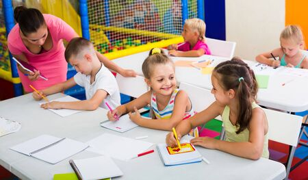 happy european  children sitting together and studying in class at school Stok Fotoğraf