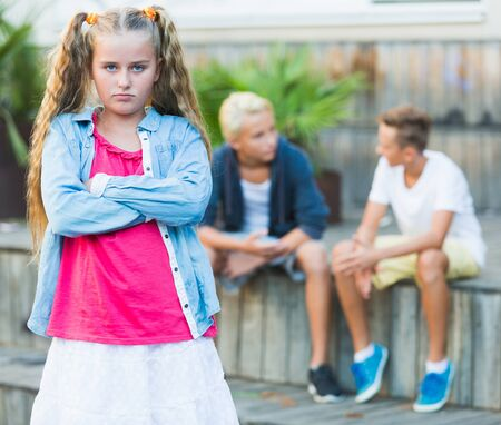 Upset girl offended after quarrel with playmates outside