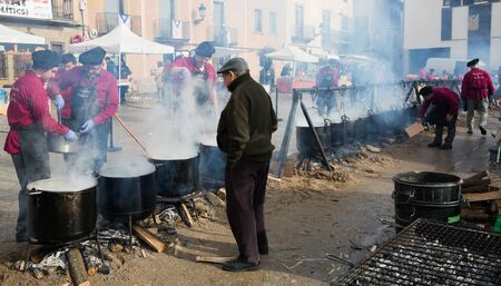 CASTELLTERCOL, SPAIN - FEBRUARY 13, 2018: Preparation of traditional Catalan soup Escudella on tuesday of Carnival on main square