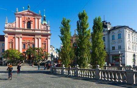 LJUBLJANA, SLOVENIA - SEPTEMBER 04, 2019: View of medieval Franciscan Church of Annunciation on Preseren Square in Ljubljana on sunny autumn day Redakční