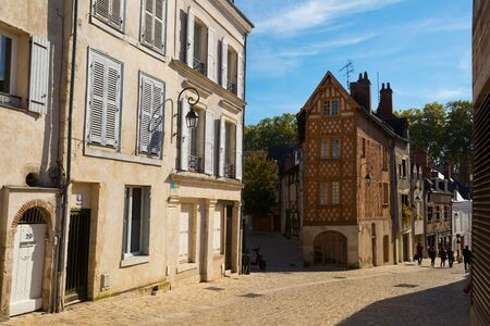 ORLEANS, FRANCE - October 09, 2018: Traditional architecture of Orleans old streets. View of half-timbered houses on narrow street in French city