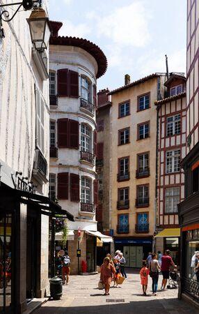 BAYONNE, FRANCE - JULY 17, 2019: Picturesque summer cityscape overlooking vibrant pedestrian street Sajtókép