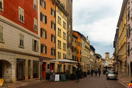TRENTO, ITALY - SEPTEMBER 02, 2019: View of typical street of ancient Italian city of Trento on cloudy autumn day Redakční