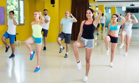 Young group of dancers are dancing aerobics in dance class.