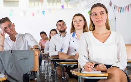 Portrait of group of different age people in lecture hall at extension courses Standard-Bild