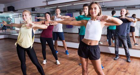 Portrait of happy men and ladies dancing  lesson