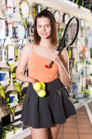 Young women racket and yellow balls for tennis