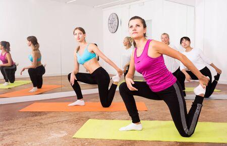 Portrait of women practicing yoga in the dancehall