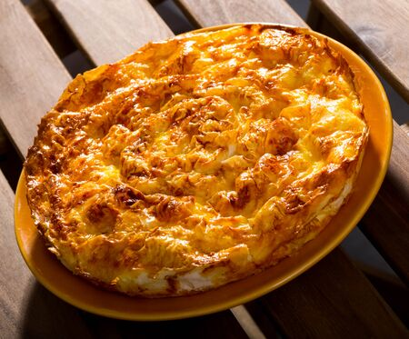 Banitsa – traditional Bulgarian dish. Whisked eggs and pieces of cheese between pastry