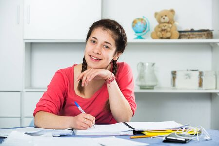 Female student having a productive day at studying at home