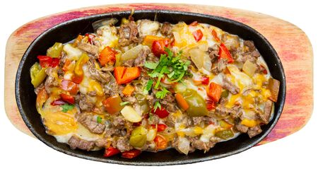 National Mexican dish alambre de ternera – veal meat roasted with vegetables and eggs. Isolated over white background Фото со стока