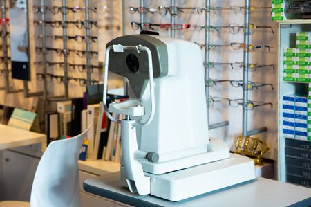 Closeup of modern auto refractometer in optical store. Technologies in eye diagnostic medicine