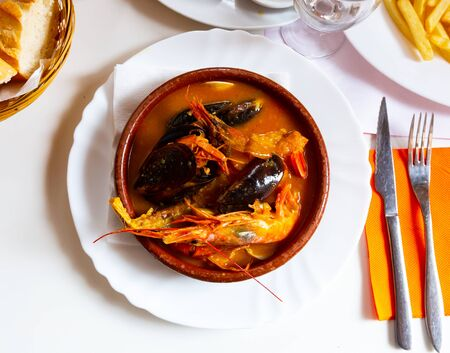 Hearty and spicy Parihuela - Peruvian seafood soup with mussels and prawns Reklamní fotografie