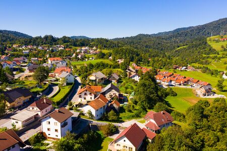 Scenic aerial view of Slovenian township of Vrhnika in valley between Ljubljana Hills in autumn day