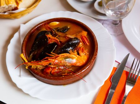 Traditional Italian seafood chowder served in clay bowl Stock Photo