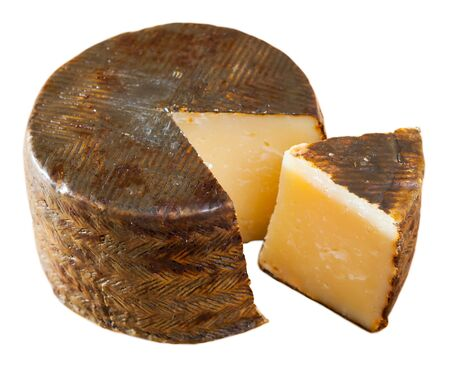 Traditional Spanish sheep cheese – Manchego. Isolated over white background