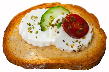 Sandwich with toasted bread, green cheese, cucumber and cherry tomato. Isolated over white background