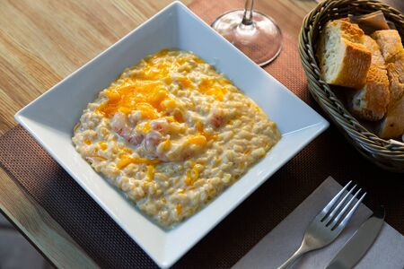 Dish of Mediterranean cuisine – Risotto with shrimps and Gratin