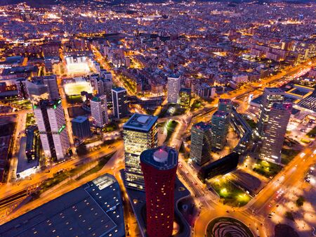 Scenic aerial view of modern neighborhood of Barcelona in night lights   Stok Fotoğraf