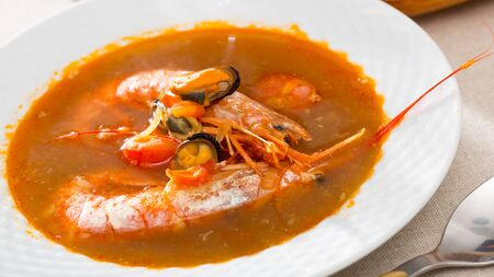 Spicy seafood broth with king prawns and shellfish