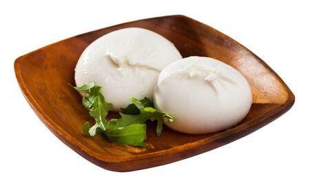 Image of burrata italian white cheese and arugula leaf closeup. Isolated over white background 写真素材