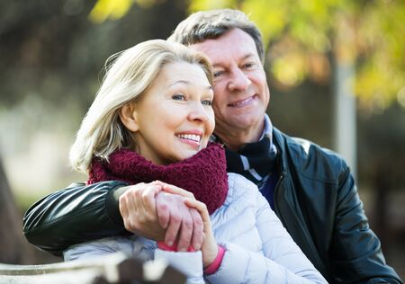 Portrait of happy senior couple spending time outdoors and enjoying together Stock Photo