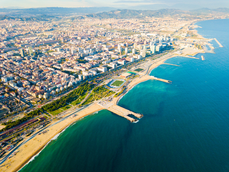 Aerial view of Barcelona coastal quarters on sunny day