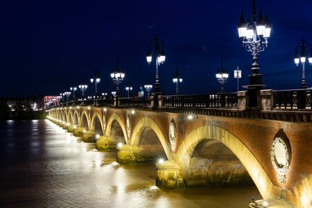 Night view of Pont de pierre, Stone Bridge in Bordeaux, Gironde department, France