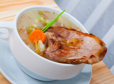 Scottish cuisine. National thick soup with lamb meat, root vegetables, pulses and barley