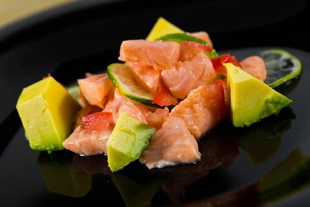 Traditional Peruvian dish - citrus avocado salmon ceviche