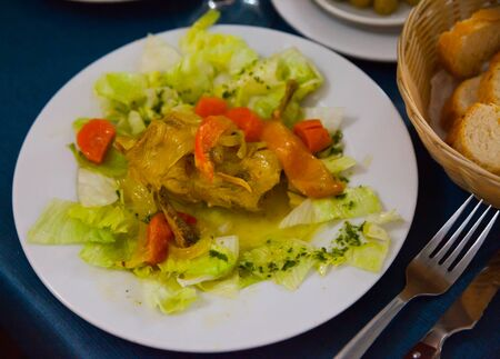Appetizing marinated quail with vegetables served on plate
