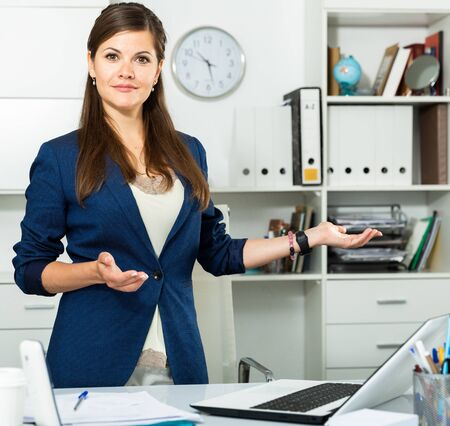 Businesswoman is going to meet first visitors in her office Stok Fotoğraf