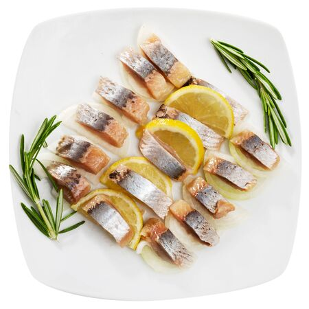 Fillet herring with rosemary, onion and lemon. Isolated over white background