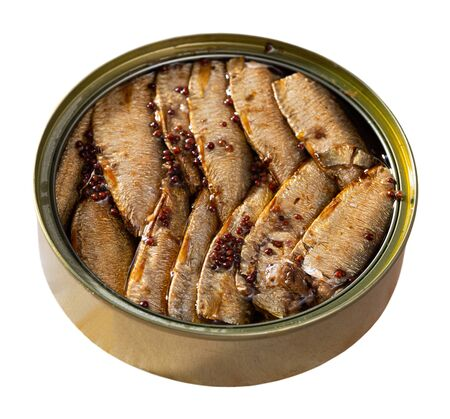 Image of canned small smoked sardines from Riga in open tin can, nobody. Isolated over white background