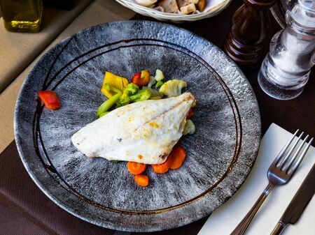 Delicious fish dish – dorado fish fillet served with boiled vegetables