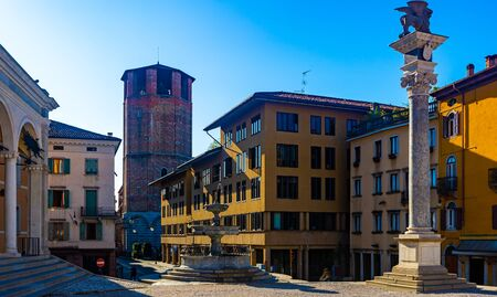 Colorful cityscape view of central square of Udine city Piazza liberta in sunny day, Italy