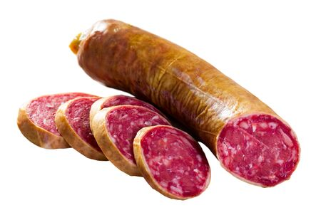 Salchichon spanish sausage slices, view from top. Isolated over white background 写真素材